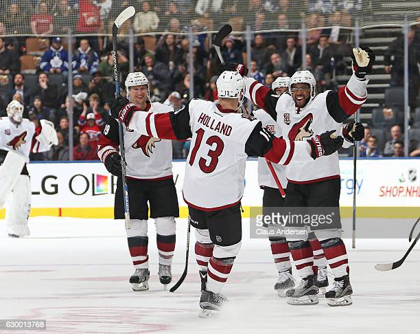 Peter Holland of the Arizona Coyotes celebrates his shootout winning goal against the Toronto Maple Leafs during an NHL game at the Air Canada Centre...