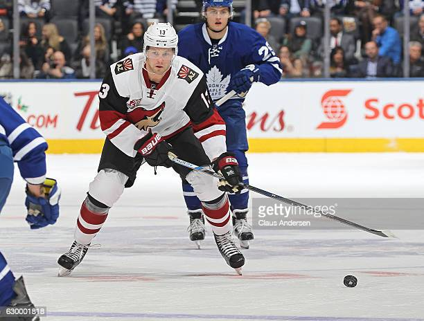 Peter Holland of the Arizona Coyotes skates after a loose puck against the Toronto Maple Leafs during an NHL game at the Air Canada Centre on...