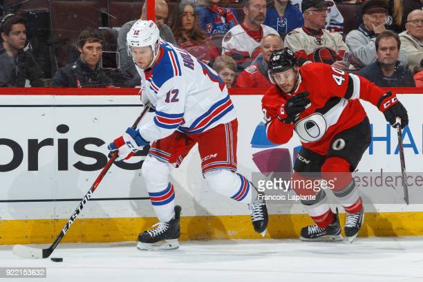 Peter Holland of the New York Rangers controls the puck against Gabriel Dumont of the Ottawa Senators at Canadian Tire Centre on February 17 2018 in...