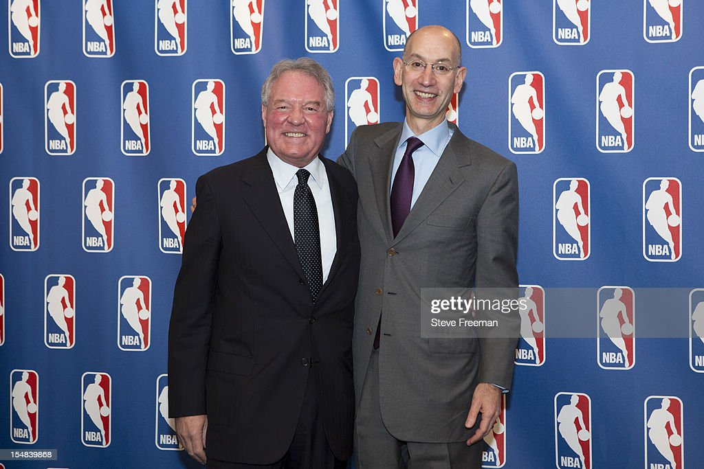 Peter Holt, Owner of the San Antonio Spurs and former chairman of the Board of Governors and Deputy Commissioner Adam Silver pose for a portrait after the Board of Governors meeting during a press conference at the St. Regis Hotel on October 25, 2012 in New York City.
