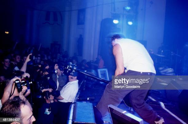 Peter Hook of New Order performs on stage at Brixton Academy London in October 2001