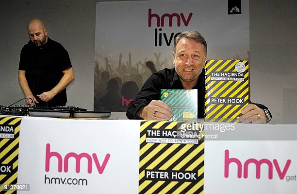 Peter Hook with DJ Jon Da Silva greets fans and signs copies of his book 'The Hacienda How Not To Run A Club' at HMV on October 3 2009 in Manchester...