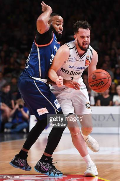Peter Hooley of Melbourne United crashes into Shannon Shorter of the Adelaide 36ers during game four of the NBL Grand Final series between the...