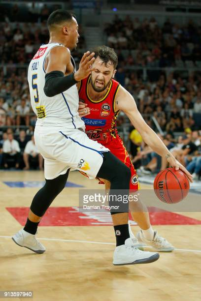 Peter Hooley of Melbourne United is called for an offensive foul on Stephen Holt of the Brisbane Bullets during the round 17 NBL match between...