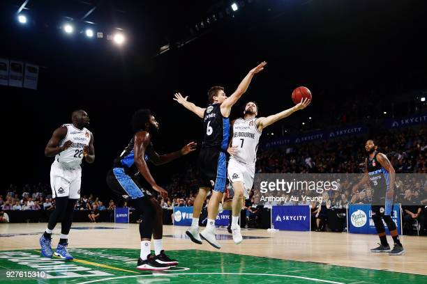 Peter Hooley of United goes up against Kirk Penney of the Breakers during game two of the NBL semi final series between Melbourne United and the New...
