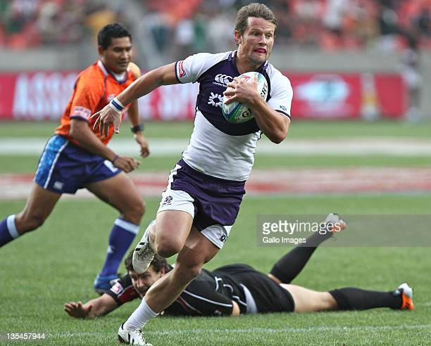 Peter Horne of Scotland runs the ball on his way to score a try during the Bowl Final on day two of the 2011 IRB South Africa Rugby Sevens at Nelson...