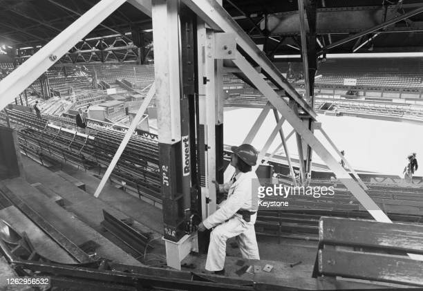 Peter Horner the steel erector foreman checks the girders supporting the 350ton roof of the Centre Court at Wimbledon in London 15th September 1978...