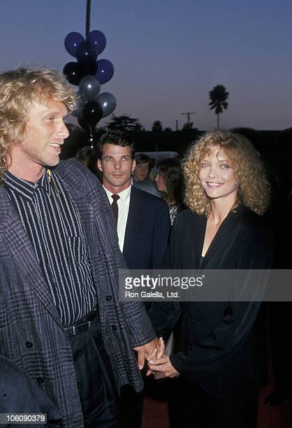 """Peter Horton and Michelle Pfeiffer during """"Married to the Mob"""" Beverly Hills Premiere at Academy Theater in Beverly Hills, California, United States."""