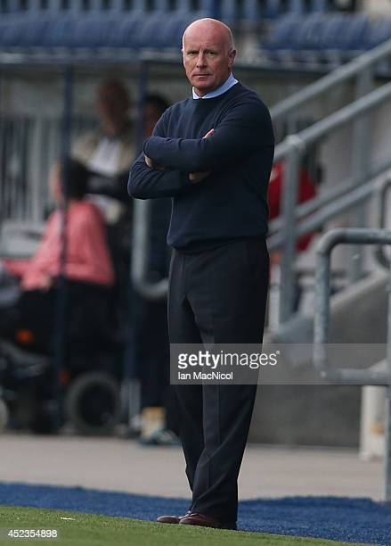 Peter Houston manager of Falkirk looks on during the Pre Season Friendly match between Falkirk v Rotherham United at The Falkirk Stadium on July 18...