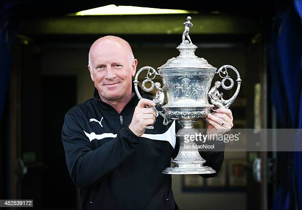 Peter Houston manager of Falkirk poses with the Stirlingshire Cup during the Stirlingshire Cup Final match between Falkirk and Stirling Albion at The...