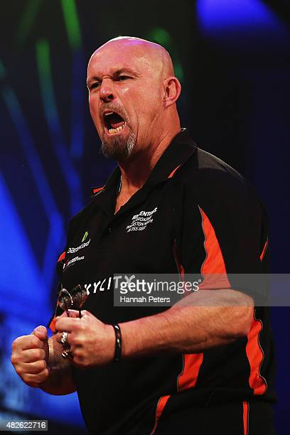 Peter Hunt celebrates after winning a game during the Super League Darts semi final match between Craig Caldwell and Peter Hunt at Sky City on August...
