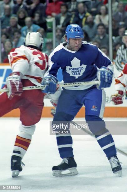 Peter Ihnacak of the Toronto Maple Leafs skates against Doug Gilmour of the Calgary Flames during NHL game action on February 22 1989 at the Olympic...