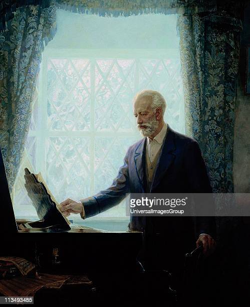 Peter Ilich Tchaikovsky Russian composer Portrait of Tchaikovsky standing by a piano looking at a score on the music stand Music Romantic Musician