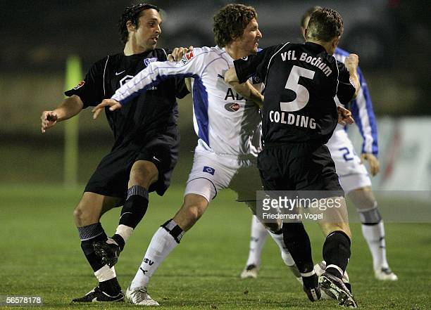 Peter Imhof and Soren Colding of Bochum challenge for the ball with Benjamin Lauth of Hamburg during the friendly match between Hamburger SV and VFL...