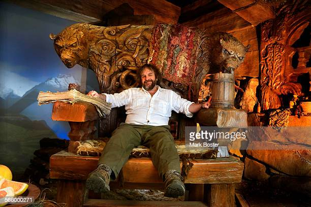 "Peter Jackson, Director of the latest J.R.R. Tolkien adaptation, ""The Hobbit: The Desolation Of Smaug"" sits in one of the giant chairs fom the actual..."
