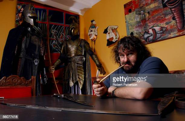 Peter Jackson New Zealand director of The Lord of the Rings trilogy poses with the props from the fil set in his Wingnut Films office in Wellington...