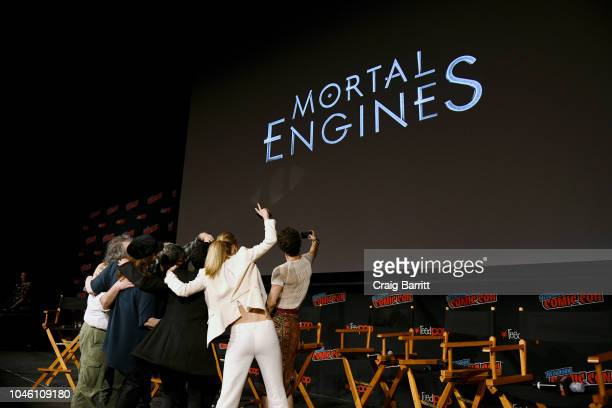 Peter Jackson Philippa Boyens Christian Rivers Hera Hilmar Robert Sheehan and Leila George D'Onofrio take a photo onstage at the Mortal Engines panel...