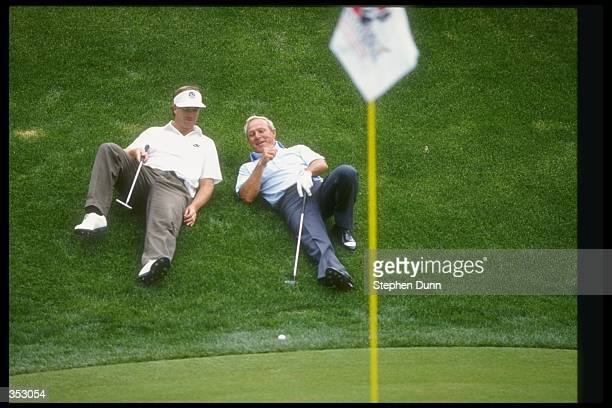 Peter Jacobsen and Arnold Palmer relax during the RMCC Invitational at the Sherwood Country Club in Thousand Oaks California Mandatory Credit Stephen...