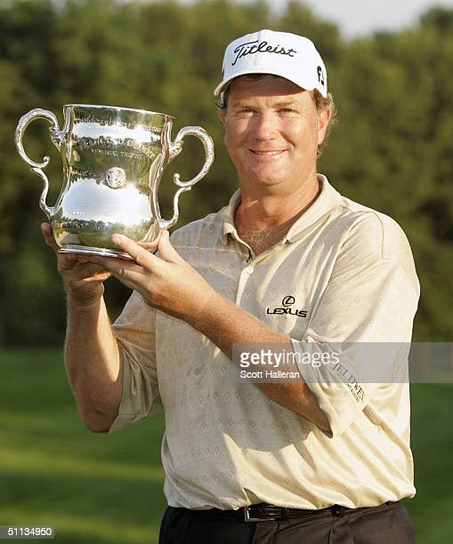 Peter Jacobsen poses with the trophy after winning the 25th US Senior Open at Bellerive Country Club on August 1 2004 in St Louis Missouri