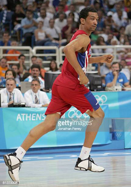 Peter John Ramos of Puerto Rico runs downcourt in the second half of the men's basketball quarterfinal game against Italy on August 26 2004 during...