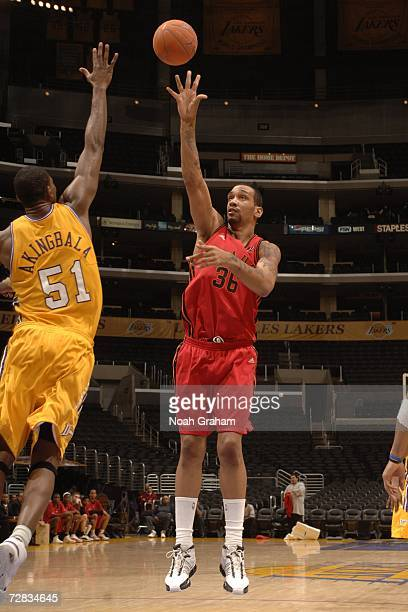 Peter John Ramos of the Idaho Stampede puts up a shot against Akin Akingbala of the Los Angeles DFenders on December 15 2006 at Staples Center in Los...