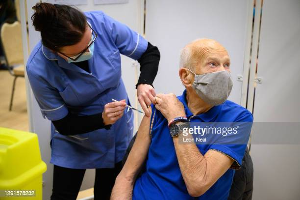 Peter Joliffe receives an injection at a COVID-19 vaccination centre on December 16, 2020 in Chertsey, England. Chertsey Hall is one of four covid-19...