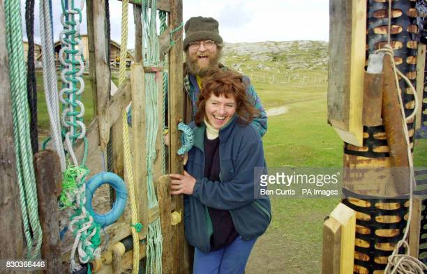 Peter Jowers and Hilary Freeman open the gate they built from items washed onto the beach on the island of Taransay in the Western Isles of Scotland...