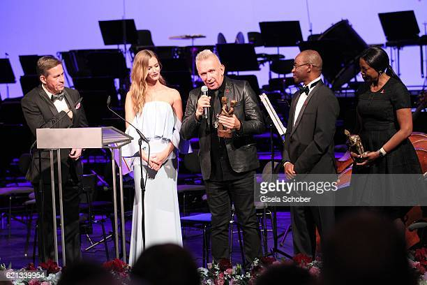 Peter Jueptner EMEA Presidentn Estee Lauder Companies Charlott Cordes Fashion Designer Jean Paul Gaultier with 'World without AIDS' Award and Strive...