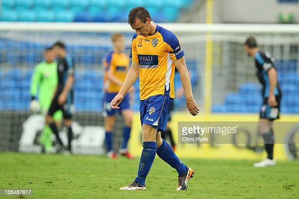 Peter Jungschlager of United looks dejected after United missed a goal during the round 10 ALeague match between Gold Coast United and Sydney FC at...