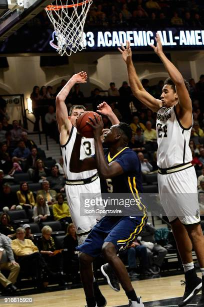 Peter Jurkin center East Tennessee State University Buccaneers draws the attention of Fletcher Magee guard and Keve Aluma forward Wofford College...