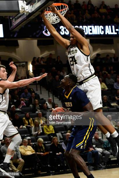 Peter Jurkin center East Tennessee State University Buccaneers draws the attention of Fletcher Magee guard Wofford College Terriers as Keve Aluma...