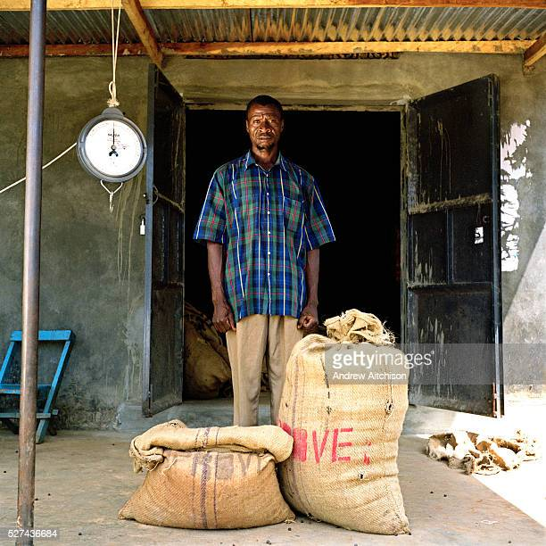 Peter Kangaala a Kulika trained coffee farmer with the coffee he has produced Peter cycled 8 km to deliver the beans which weighed 45kgs he received...
