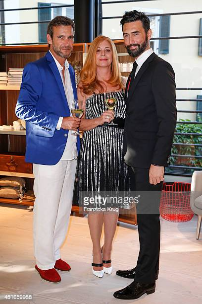 Peter Kanitz, Olivia Pascal and Athanasios Megarisiotis attend the Bulthaup Showroom Opening on July 03, 2014 in Munich, Germany.