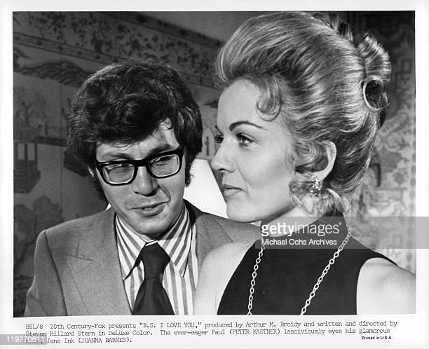 Peter Kastner eyes his glamorous boss Joanna Barnes in a scene from the film 'BS I Love You' 1971