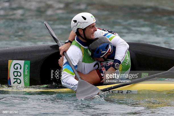 Peter Kauzer of Slovenia and Joseph Clarke of Great Britain celebrate after winning silver and gold, respectively, in the Kayak Men's Final on Day 5...