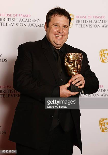 Peter Kay winner of the Male Performance in a Comedy Programme for 'Peter Kay's Car Share' poses in the winners room at the House Of Fraser British...