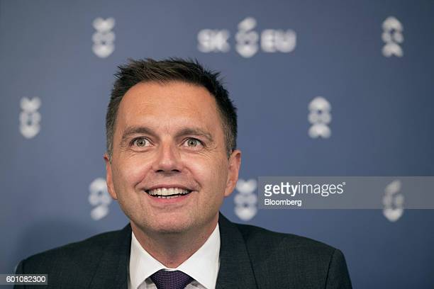 Peter Kazimir Slovakia's finance minister smiles while speaking during a press conference following a meeting of European finance ministers in...