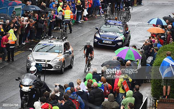 Peter Kennaugh of Isle of Man cycles along Great George Street in the Men's Road Race during day eleven of the Glasgow 2014 Commonwealth Games on...