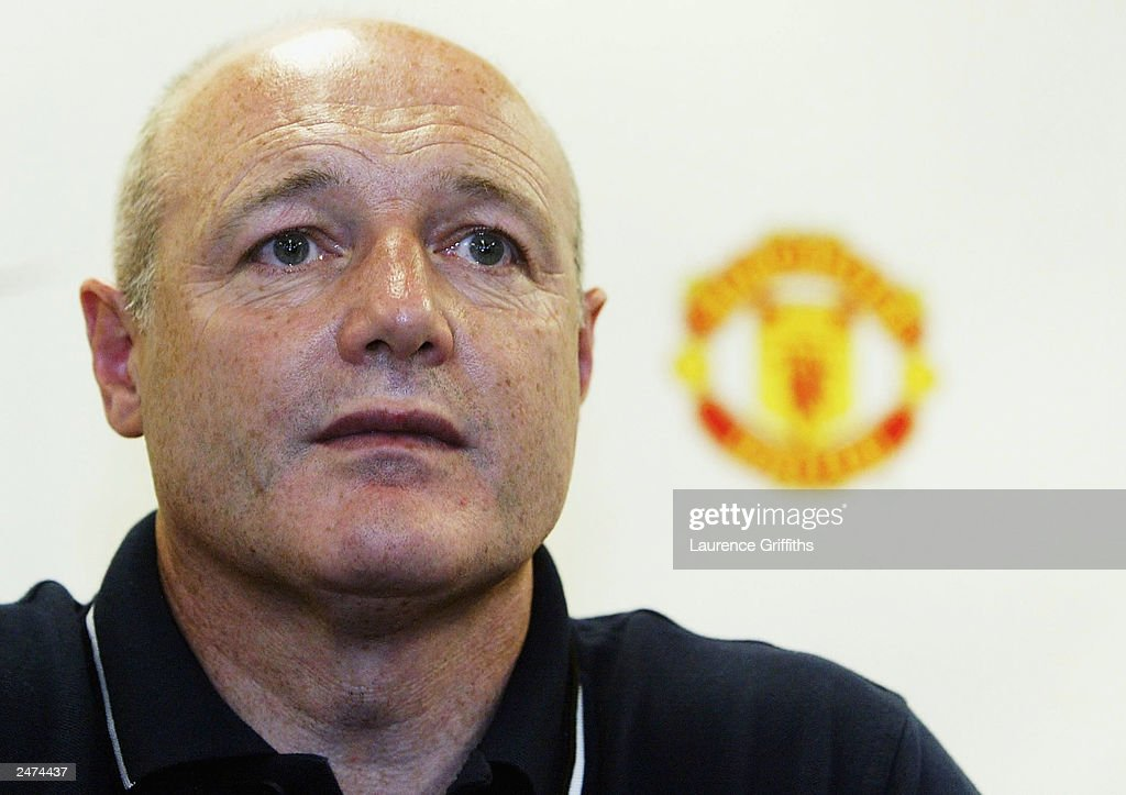 Peter Kenyon, chief executive of Manchester United, talks to the press after during their American Tour on July 20, 2003 at the Nike Training Facility in Portland, Oregon. Kenyon resigned as Chief Executive of Manchester United September 9, 2003 to take up a position with Chelsea.