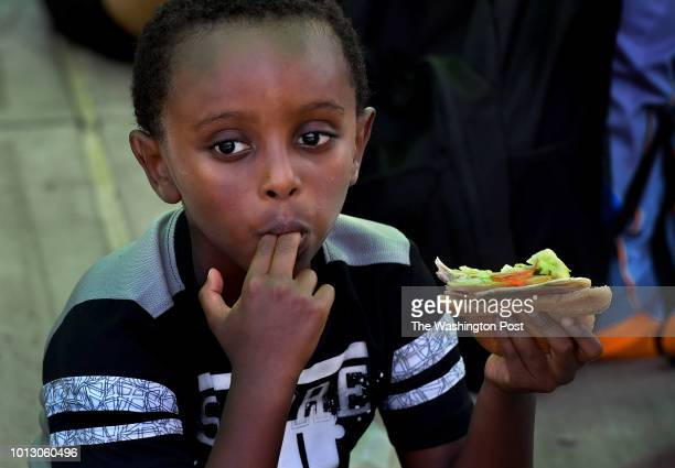 Peter Kidus enjoys a free lunch at Germantown Center Park Neighborhood kids meet up at the Germantown Library and then walk to the adjacent...