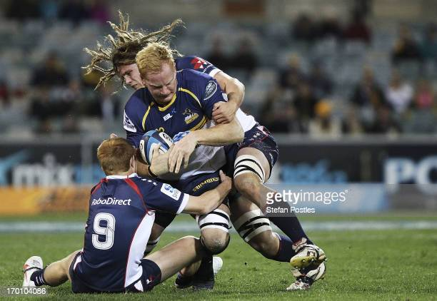 Peter Kimlin of the Brumbies is tackled during the round 17 Super Rugby match between the Brumbies and the Rebels at Canberra Stadium on June 7, 2013...