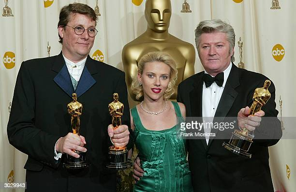 Peter King Scarlett Johansson and Richard Taylor poses with the Oscar for Best Achievement in Makeup during the 76th Annual Academy Awards at the...