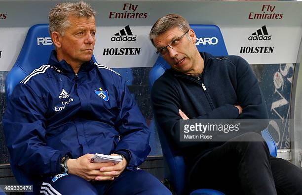 Peter Knaebel , head caoch of Hamburg talks to assistant coach Peter Hermann before the Bundesliga match between Hamburger SV and VfL Wolfsburg at...