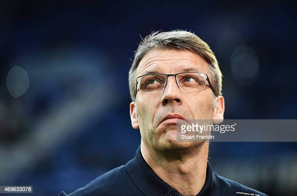 Peter Knaebel, head coach of Hamburg looks on during the Bundesliga match between Hamburger SV and VfL Wolfsburg at Imtech Arena on April 11, 2015 in...
