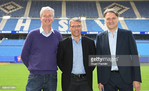 Peter Knäbel poses for a picture with Bernhard Peters, director of sport and Dietmar Beiersdorfer, chairman of Hamburger SV, after he was announced...