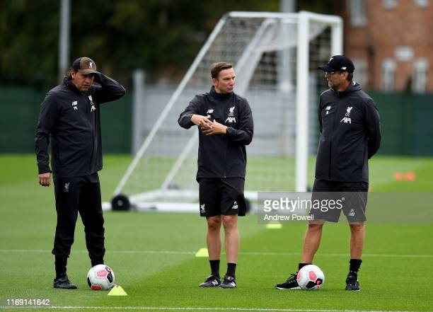 Peter Krawietz and Pepijn Lijnders assistant managers of Liverpool with Jurgen Klopp manager of Liverpool during a training session at Melwood...