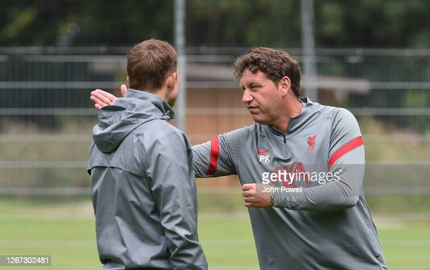 Peter Krawietz of Liverpool with Pepijn Lijnders of Liverpool during a training session on August 20, 2020 in Salzburg, Austria.
