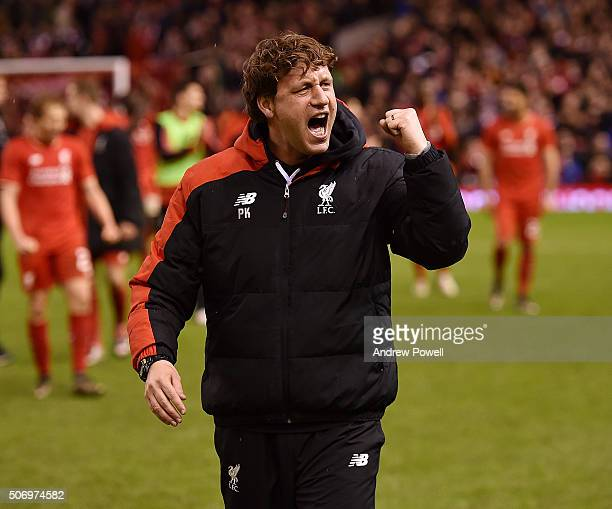 Peter Krawietz Second assistant coach of Liverpool celebrates the win at the end of the Capital One Cup Semi Final Second Leg between Liverpool and...