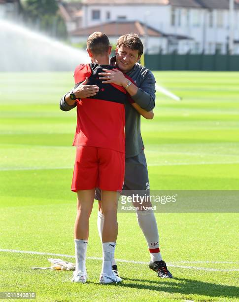 Peter Krawietz second assistant coach of Liverpool embracing Jordan Henderson during a training session at Melwood Training Ground on August 5 2018...