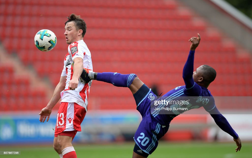 Peter Kurzweg of 1 FC Union Berlin and Joel Fameyeh of Dinamo Brest compete for the ball during the game between Union Berlin and FK Dinamo Brest on october 5, 2017 in Berlin, Germany.